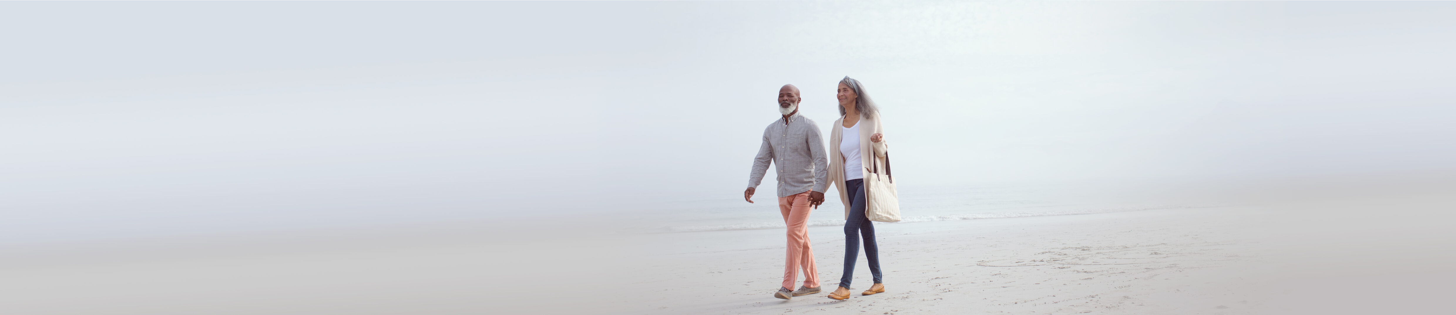 A couple walking at the beach