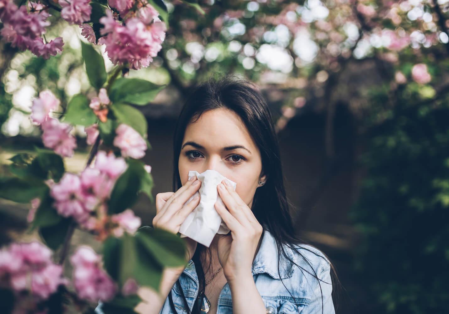 Woman using a facial tissue